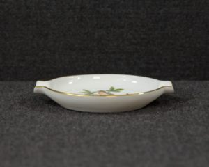 An ashtray made by Herend Hungary featuring a decoration called 'Rothschild'.