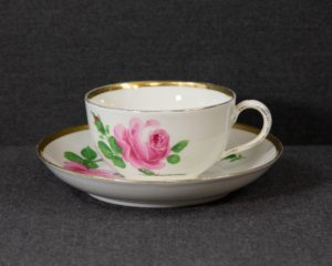 A mismatched Meissen Rote Rose Teacup.