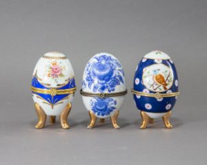 Three Egg Shaped Porcelain Canisters