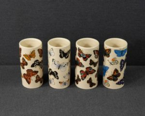 A Dennis Chinaworks Set of Four Butterfly Vases.