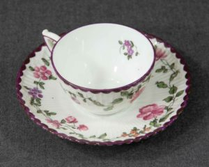 An antique hand painted demitasse.