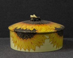 A Dennis Chinaworks Bee and Sunflower Jar.