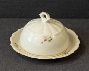 A Carl Tielsch Altwasser Butter dish.  The butter dish was made by Carl Tielsh Altwasser in Germany. It has been decorated with a floral decor. The butter dish is numbered 41.  The item measures 36.5cm in width.  The item is in a perfect condition.